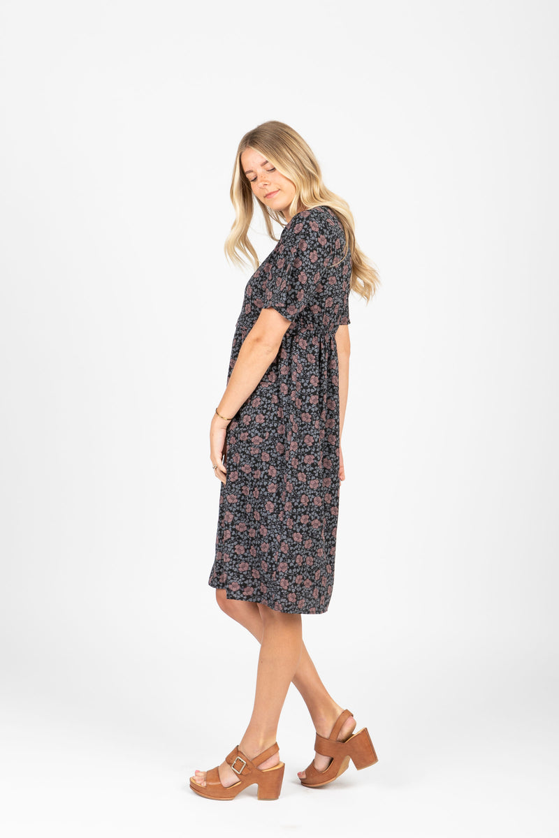 Piper & Scoot: The Jack Floral Bib Dress in Black, studio shoot; side view