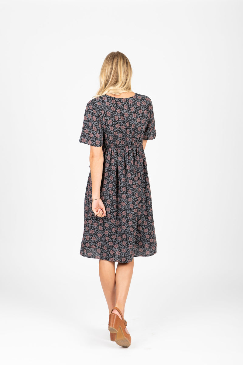 Piper & Scoot: The Jack Floral Bib Dress in Black, studio shoot; back view