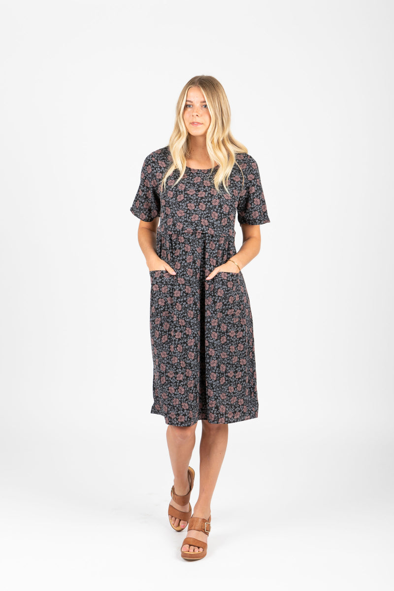 Piper & Scoot: The Jack Floral Bib Dress in Black, studio shoot; front view