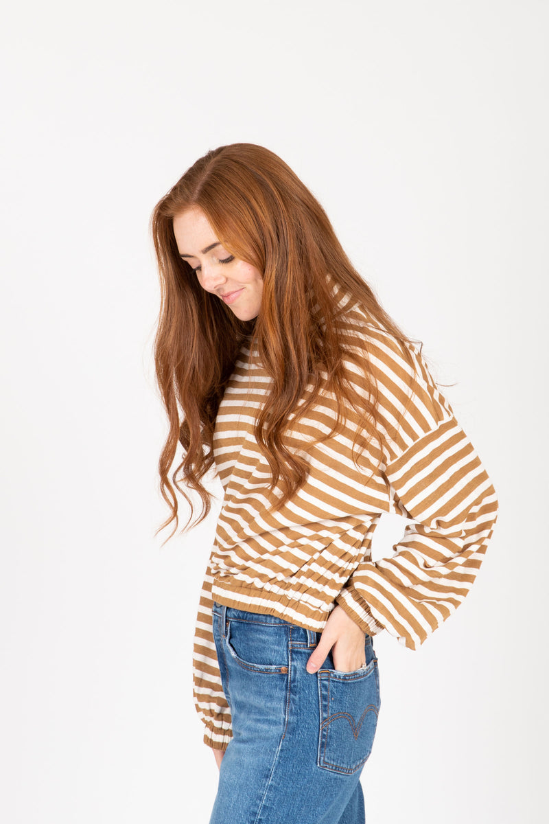 The Bertie Striped Mock Neck Blouse in Mustard, studio shoot; side view