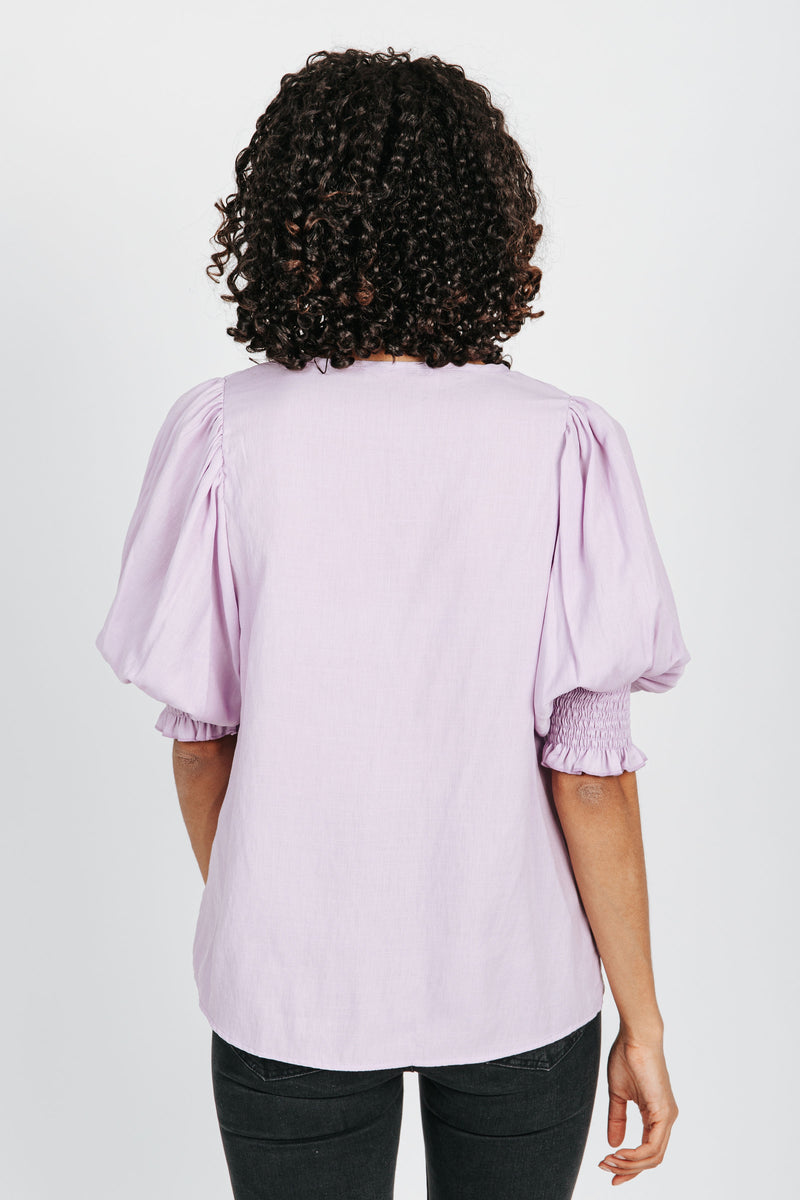The Janelle Puff Sleeve Blouse in Lavender, studio shoot; back view