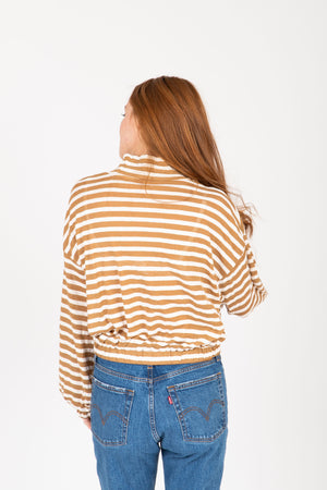 The Bertie Striped Mock Neck Blouse in Mustard, studio shoot; back view