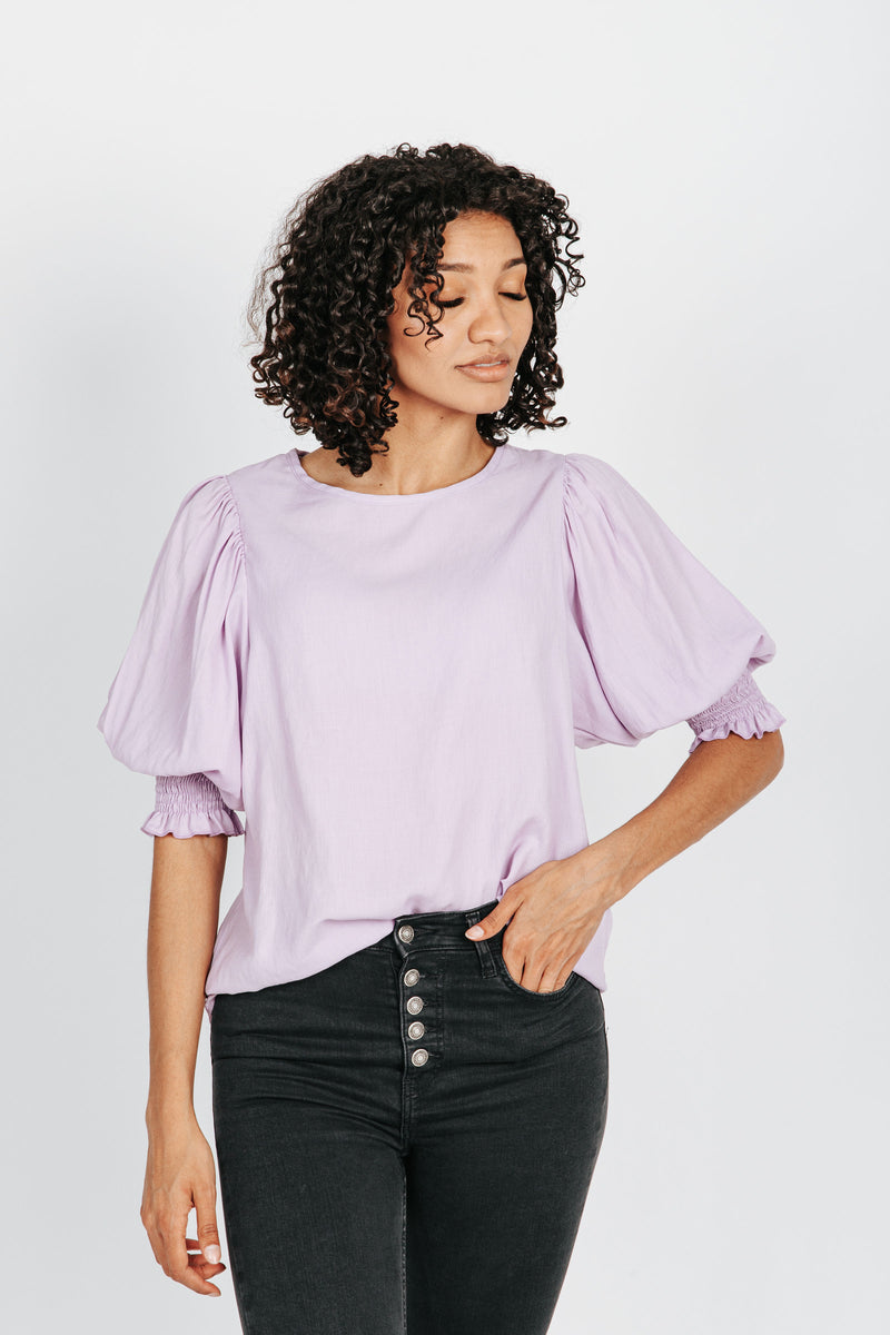 The Janelle Puff Sleeve Blouse in Lavender, studio shoot; front view