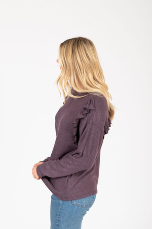The Sheila Ruffle Sweater Blouse in Plum, studio shoot; side view