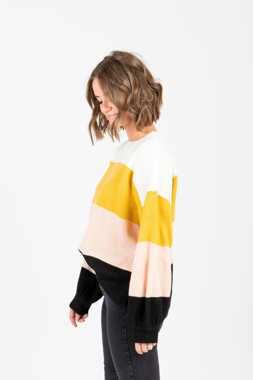 The Raider Block Sweater in Mustard, studio shoot; side view