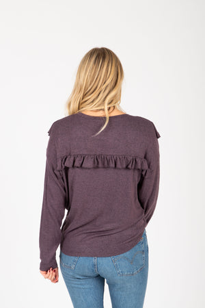 The Sheila Ruffle Sweater Blouse in Plum, studio shoot; back view