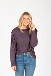 The Sheila Ruffle Sweater Blouse in Plum, studio shoot; front view