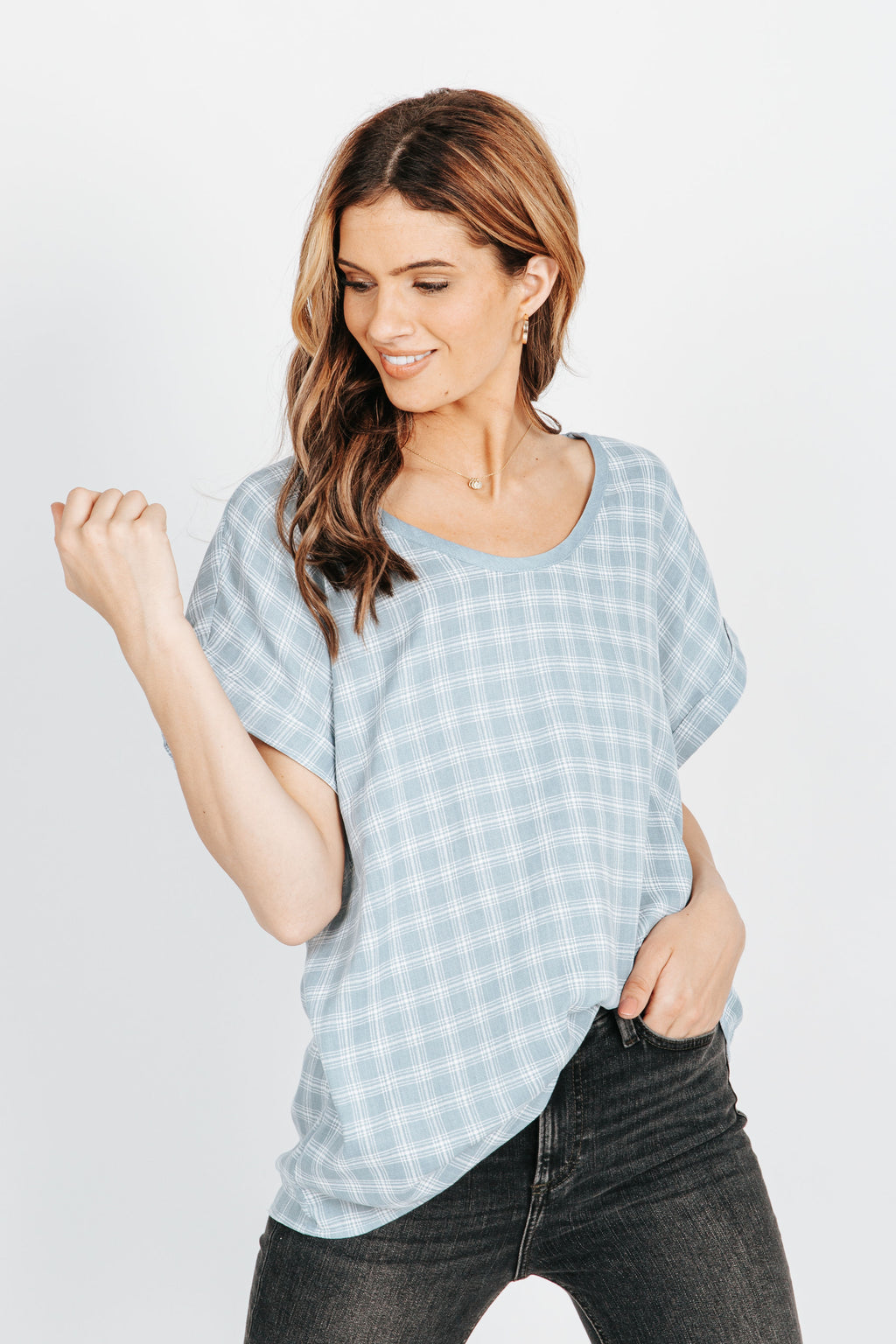 The Zoey Checkered Blouse in Light Blue, studio shoot; front view