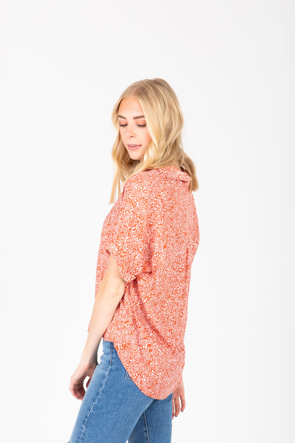 The Camdyn Printed Collared Blouse in Poppy, studio shoot; side view