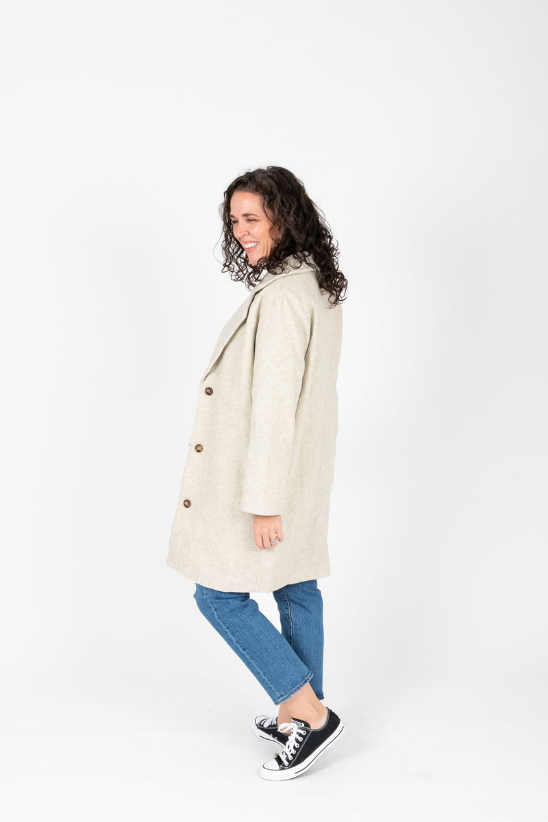 The Wilkins Collared Pocket Coat in Ash, studio shoot; side view