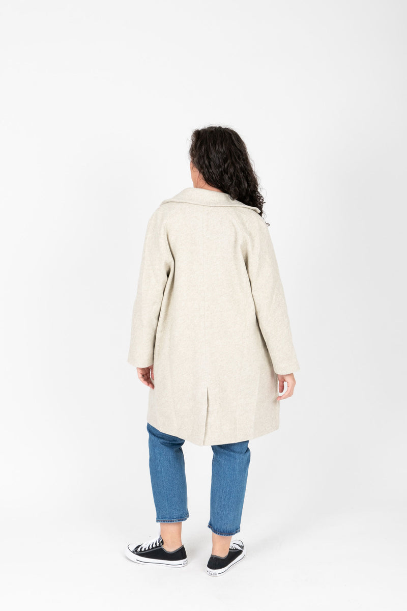 The Wilkins Collared Pocket Coat in Ash, studio shoot; back view