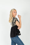 The Dimarco Textured Detail Blouse in Black, studio shoot; side view