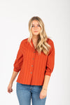 The Stuart Button Blouse in Brick, studio shoot; front view