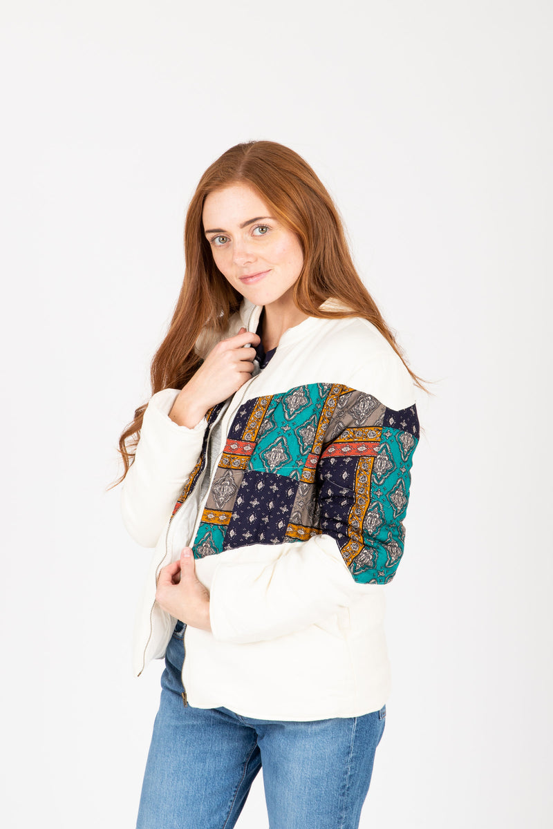 The Deanne Patterned Puffer Coat in Ivory, studio shoot; side view