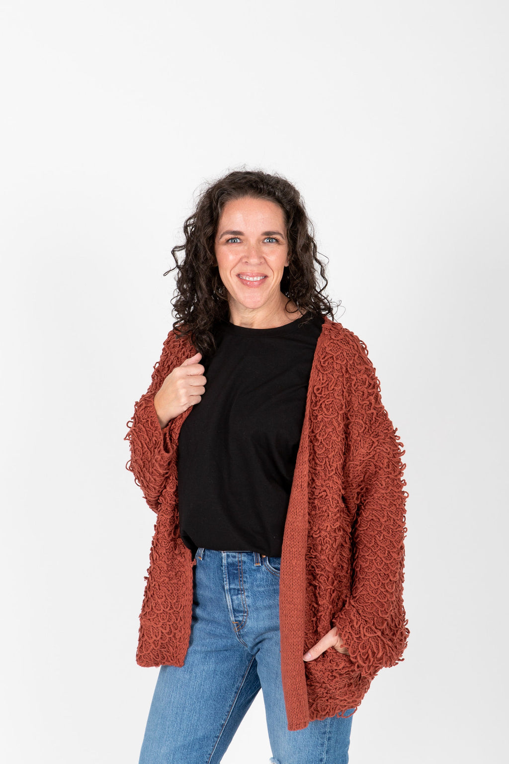 The Regina Crochet Detail Cardigan in Brick, studio shoot; front view