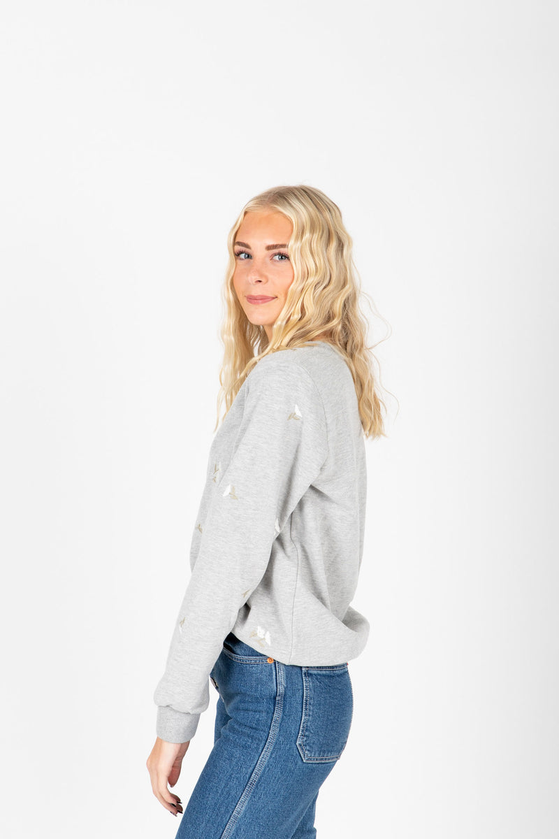 The Roe Embroidered Detail Sweatshirt in Heather Grey, studio shoot; side view