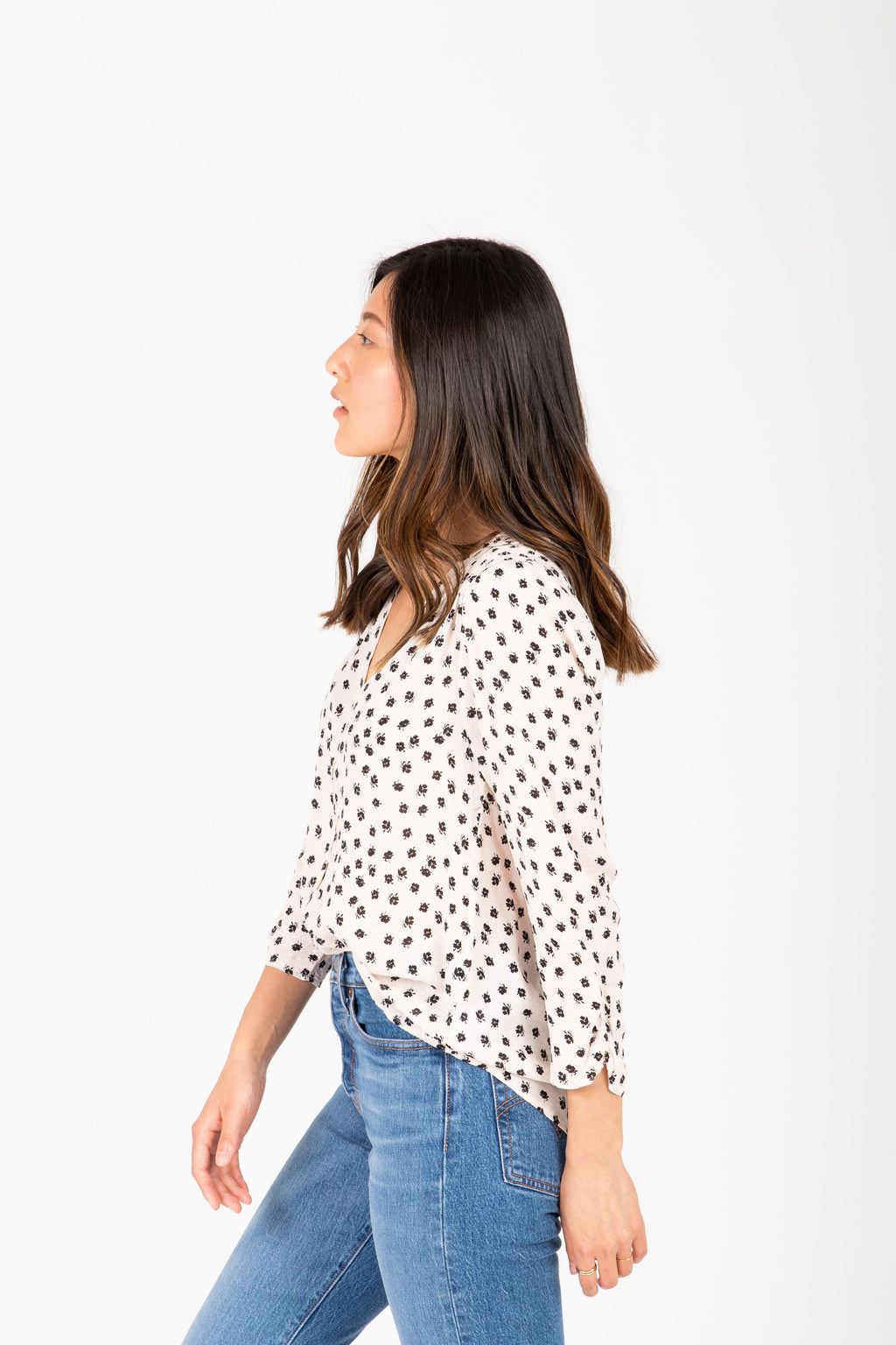 The Vance Printed Button Blouse in Pale Pink, studio shoot; side view