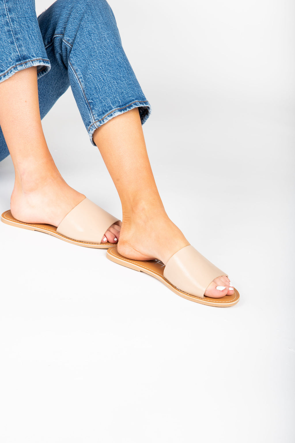 Coconuts by Matisse: Cabana Slide Sandal in Natural, studio shoot; side view