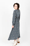 The Stellar Embroidered Dress in Slate, studio shoot; side view