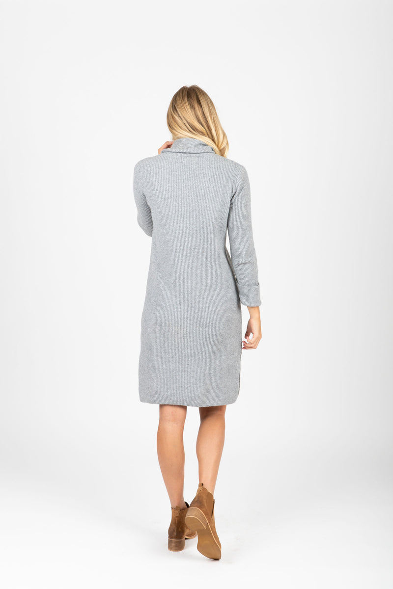 The Revive Ribbed Turtleneck Sweater Dress in Heather Grey, studio shoot; back view
