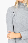 The Revive Ribbed Turtleneck Sweater Dress in Heather Grey, studio shoot; closer up front view