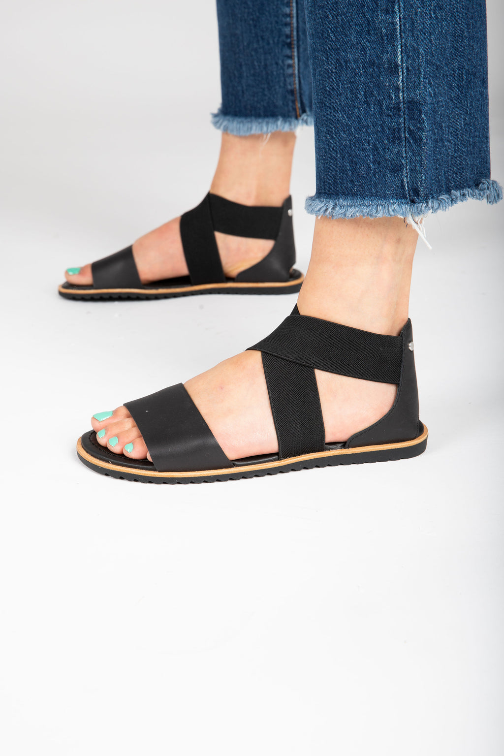SOREL: Ella Sandal in Black, studio shoot; side view