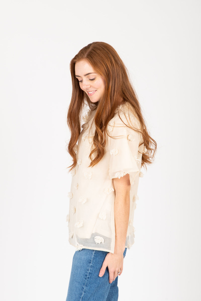 The Marcia Textured Dot Blouse in Cream, studio shoot; side view
