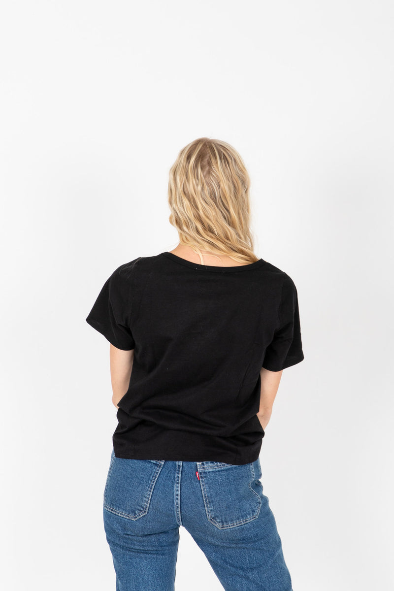 The Lippie Graphic Band Tee in Black, studio shoot; back view