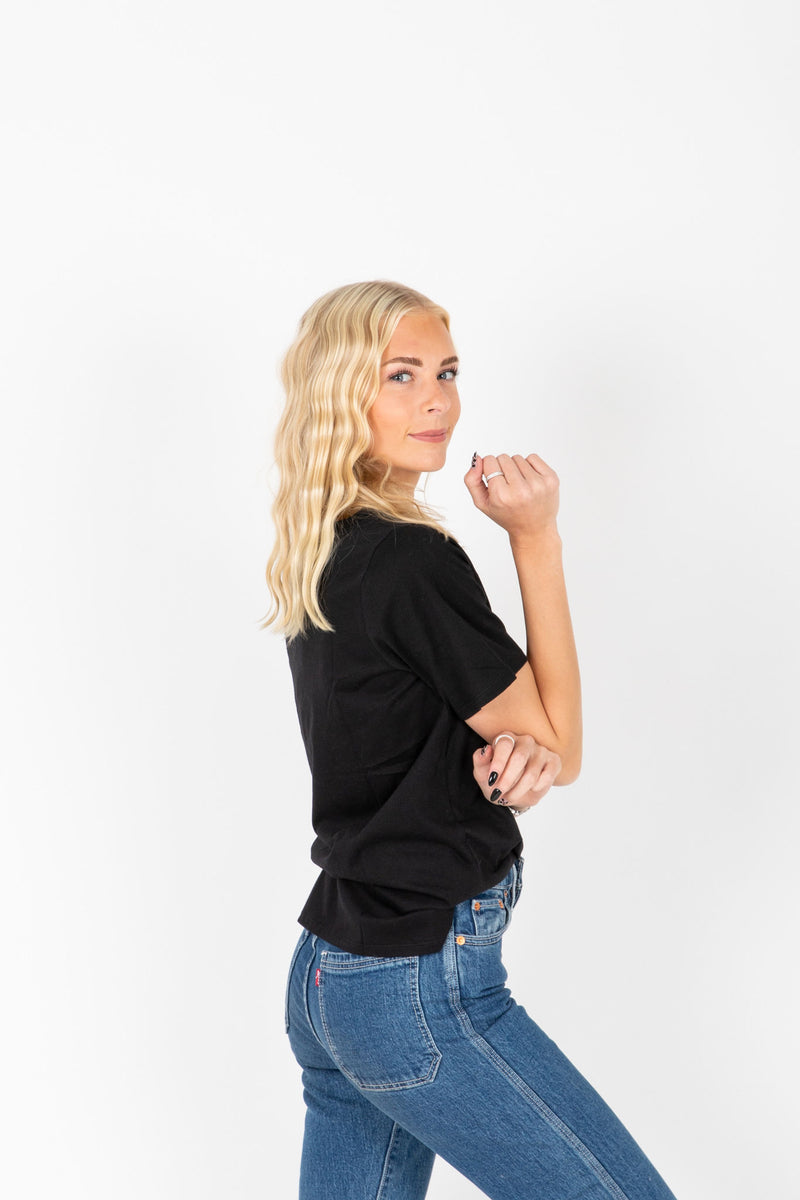 The Lippie Graphic Band Tee in Black, studio shoot; side view
