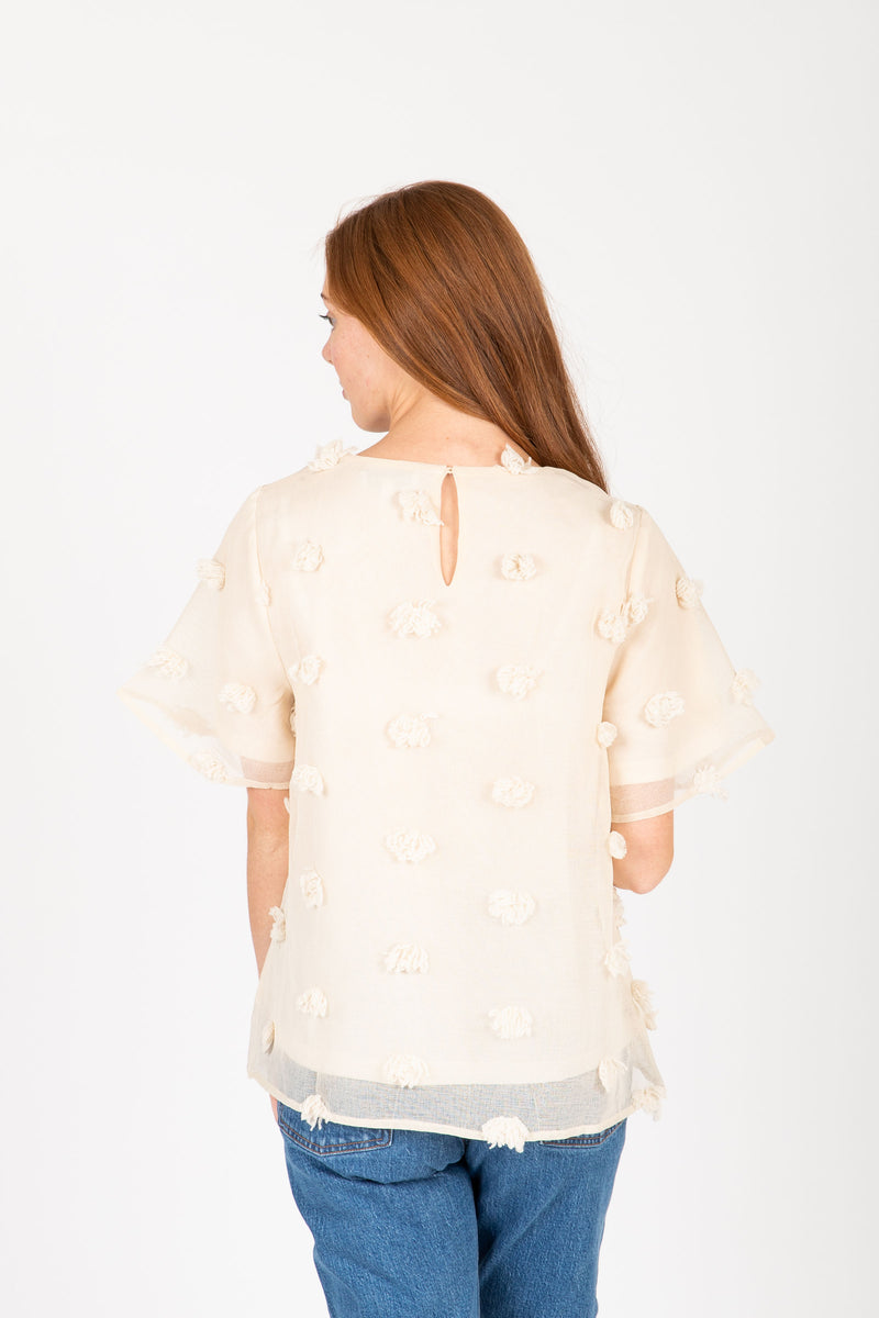 The Marcia Textured Dot Blouse in Cream, studio shoot; back view