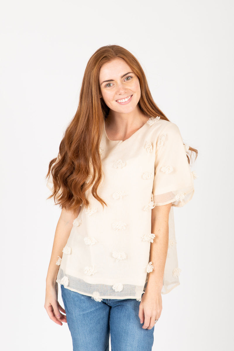 The Marcia Textured Dot Blouse in Cream, studio shoot; front view