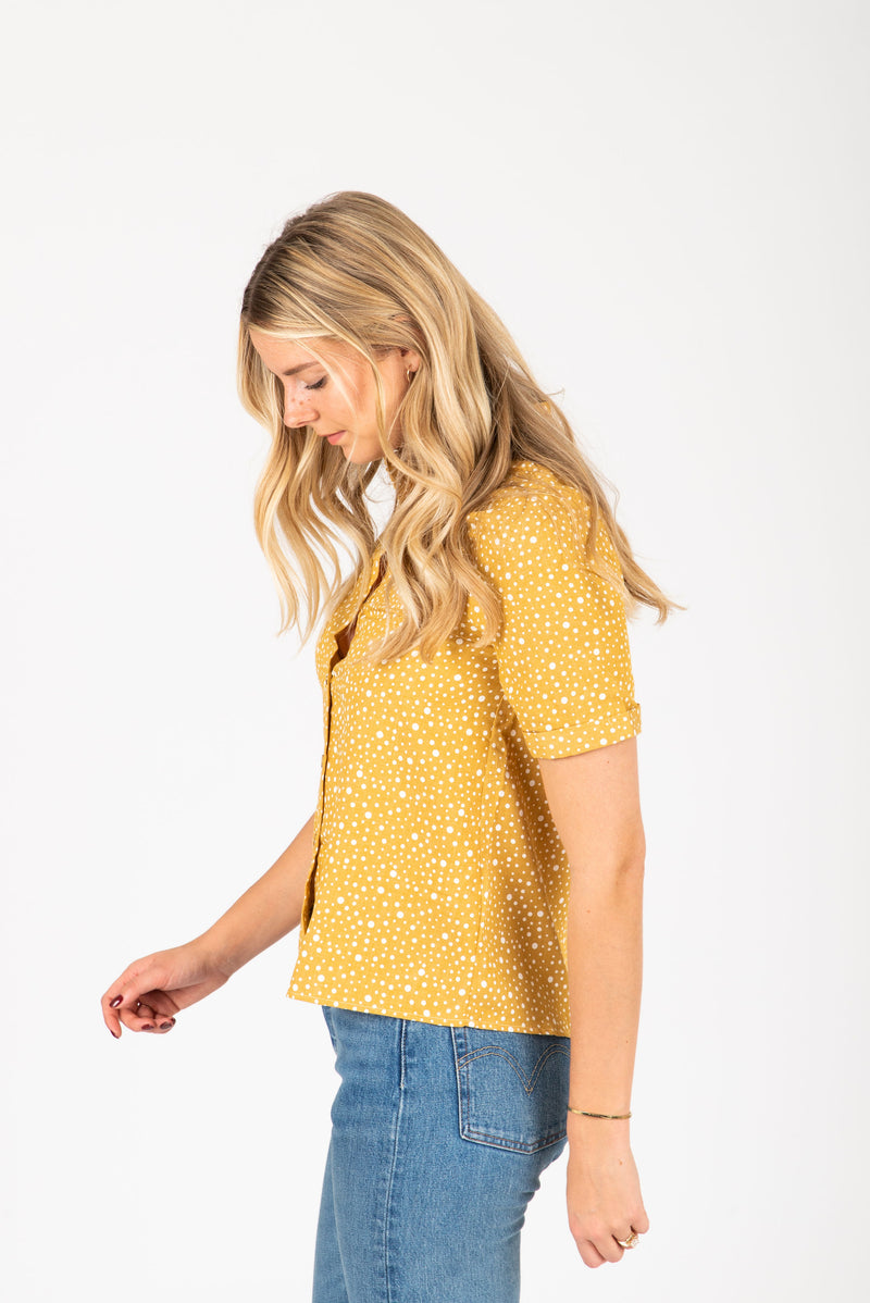The Hunte Patterned Button Blouse in Mustard, studio shoot; side view
