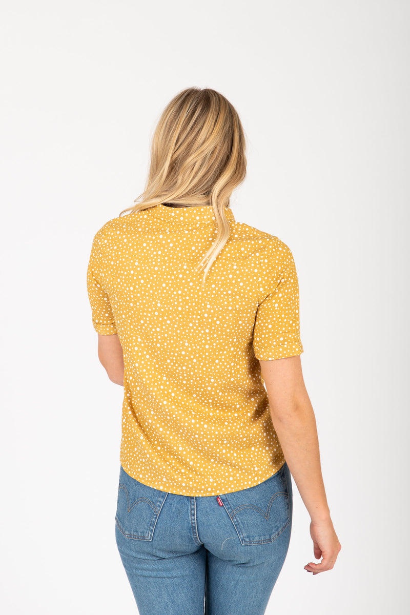 The Hunte Patterned Button Blouse in Mustard, studio shoot; back view