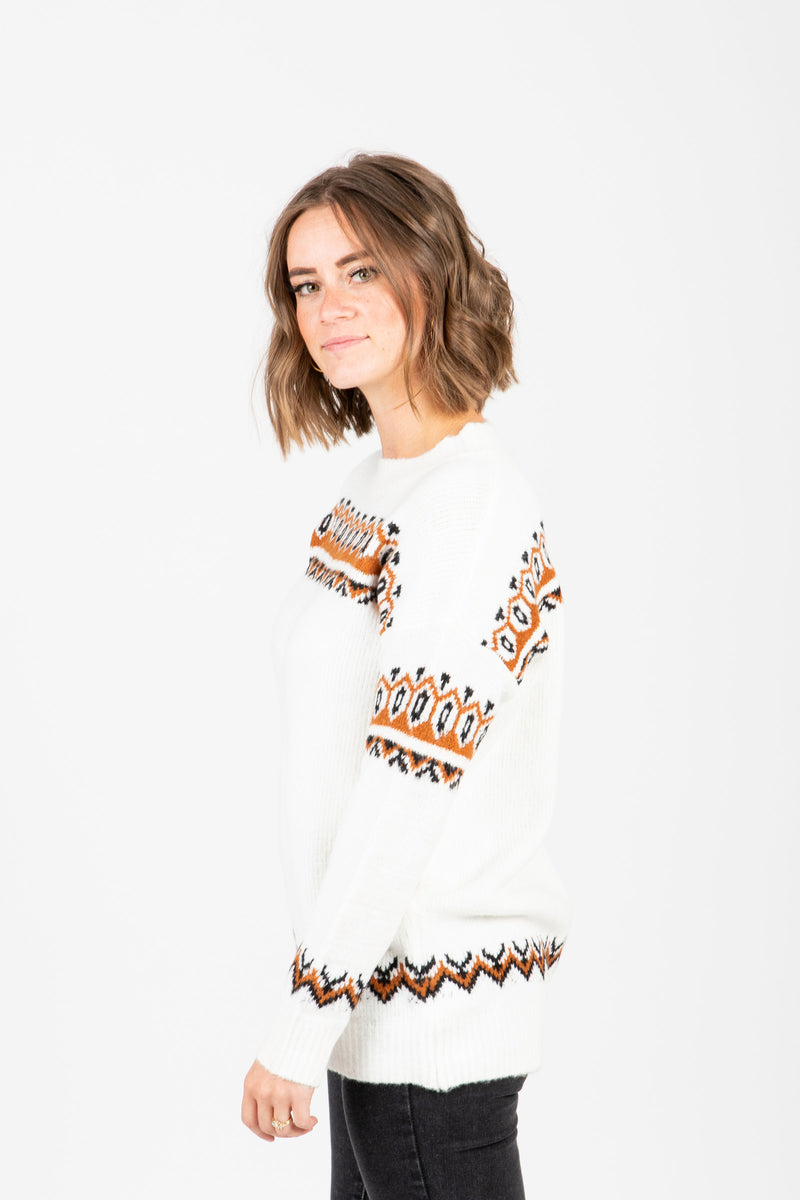 The Finch Patterned Sweater in Cream, studio shoot; side view