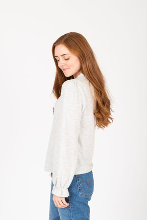 The Evaline Cozy Ruffle Sweater Blouse in Heather Grey, studio shoot; side view