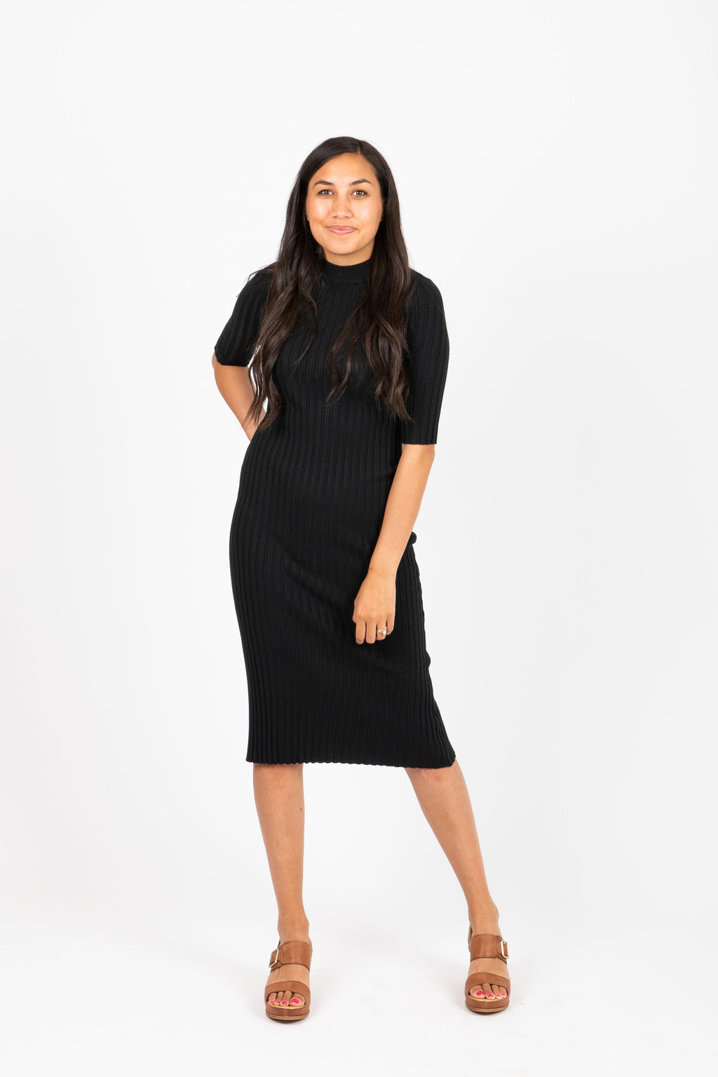 The Eugene Ribbed Sweater Dress in Black, studio shoot; front view