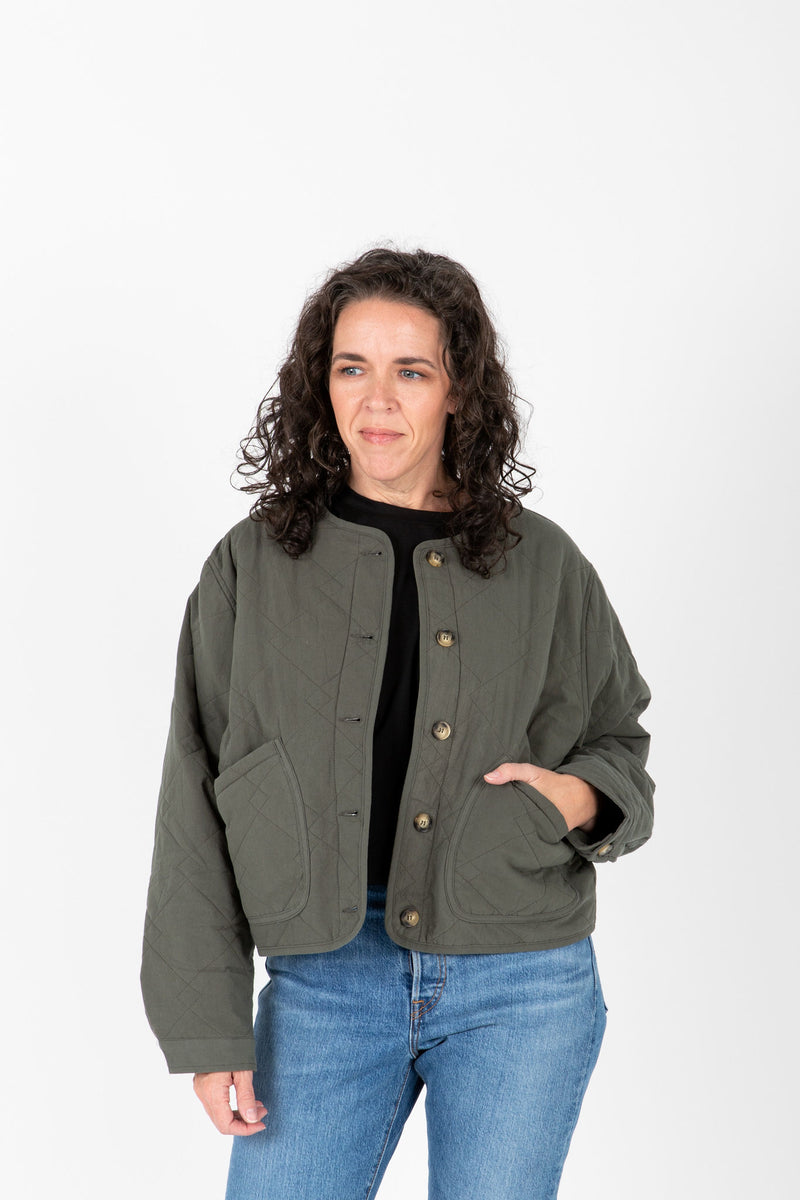 The Janine Quilted Jacket in Olive, studio shoot; front view