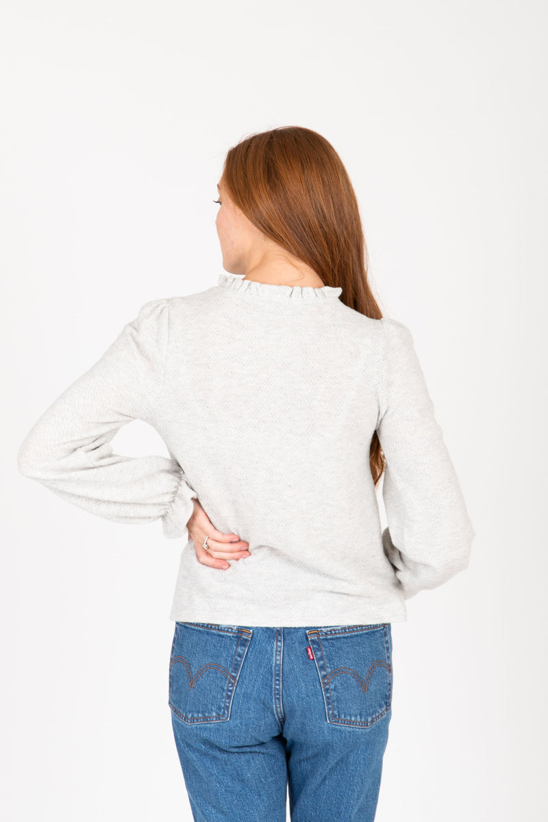 The Evaline Cozy Ruffle Sweater Blouse in Heather Grey, studio shoot; back view