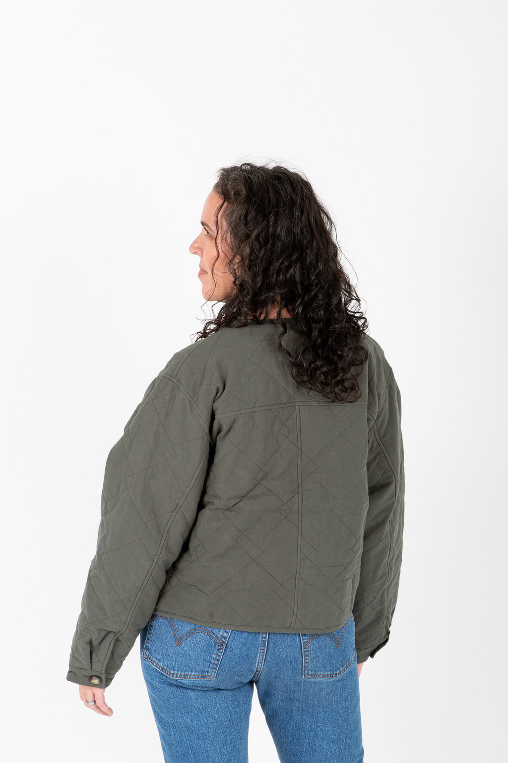 The Janine Quilted Jacket in Olive, studio shoot; back view