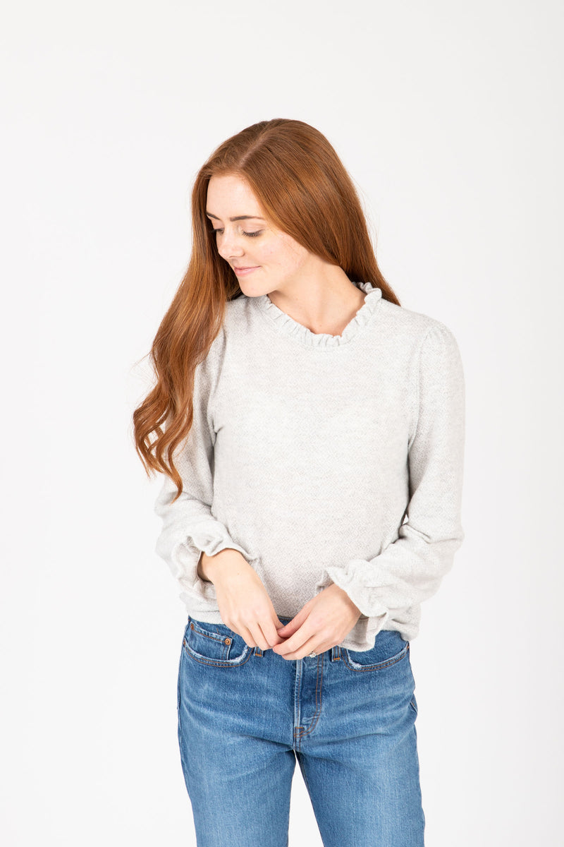 The Evaline Cozy Ruffle Sweater Blouse in Heather Grey, studio shoot; front view