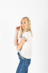 The Nyle Embroidered Detail Blouse in Cream, studio shoot; side view