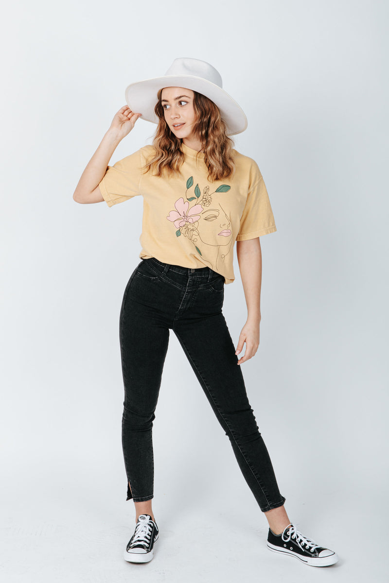 The Flower Lady Graphic Tee in Mustard, studio shoot; front view