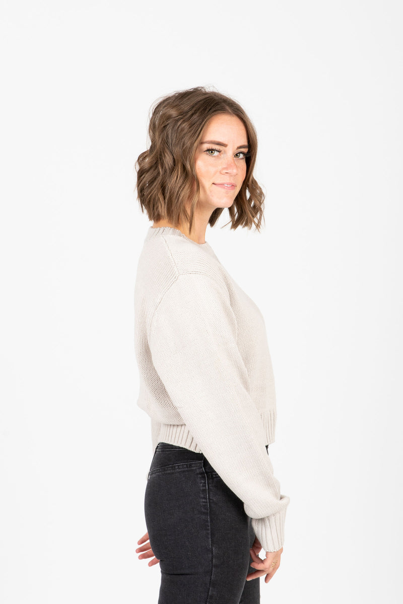 The Barnett Ribbed Trim Sweater in Taupe, studio shoot; side view