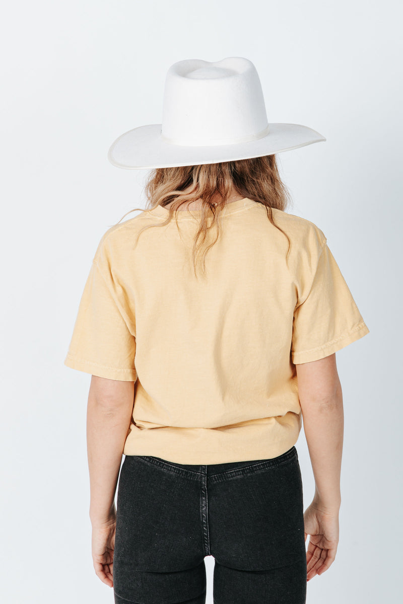 The Flower Lady Graphic Tee in Mustard, studio shoot; back view