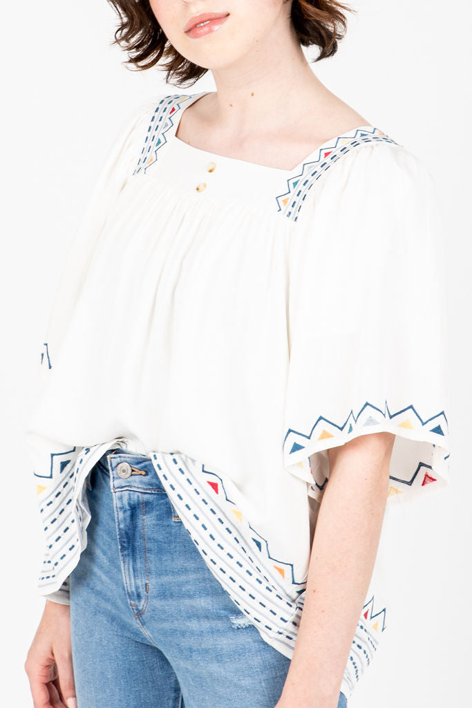 The Howell Embroidered Blouse in White, studio shoot; front view