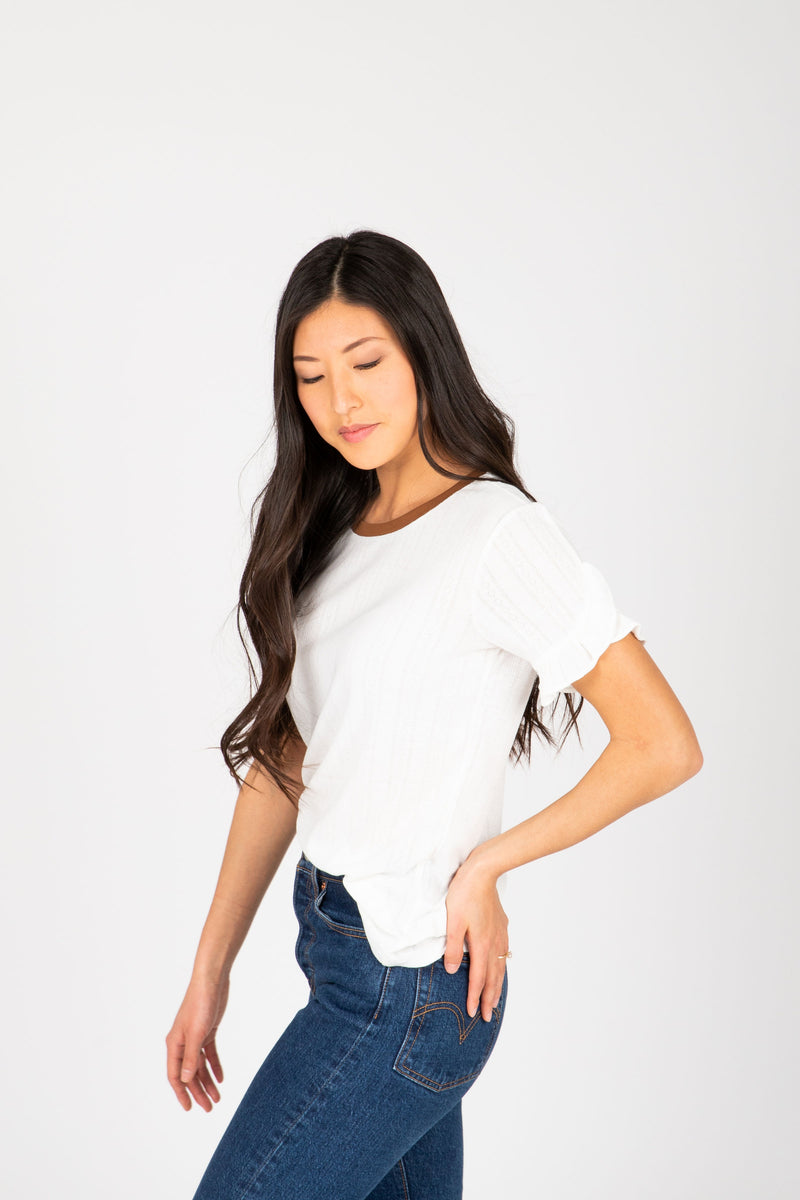 The Alisha Detail Blouse in Ivory, studio shoot; side view