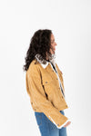 Levi's: Heritage Corduroy Trucker Jacket in Iced Coffee, studio shoot; side view
