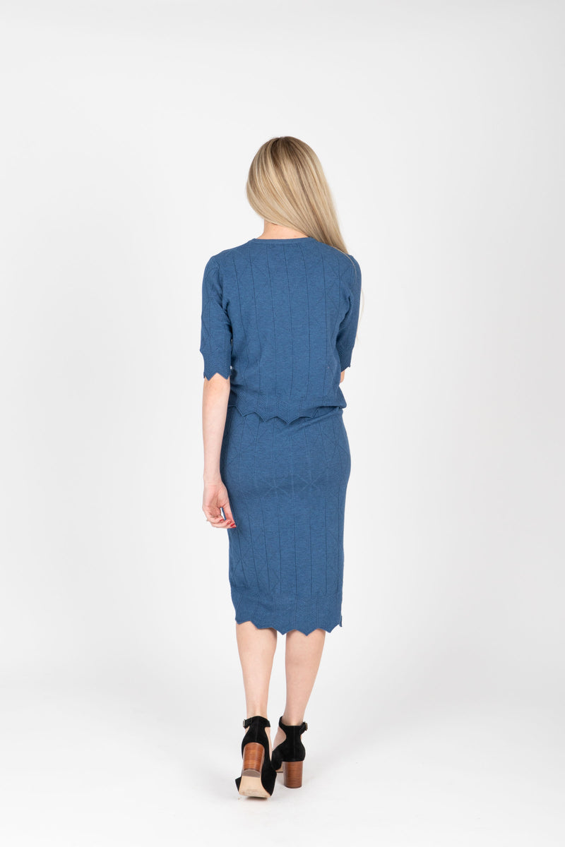 The Jessie Sweater Blouse in Indigo, studio shoot; back view