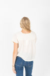The Arkusen Crochet Detail Blouse in Cream, studio shoot; back view