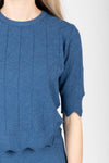 The Jessie Sweater Blouse in Indigo, studio shoot; closer up front view